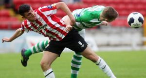 Derry's Ryan McBride and Shamrock Rovers' Conor Kenna tussle for possesion in their Premier Division match at the Brandywell. Photograph: Lorcan Doherty/Inpho.