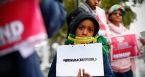 South Africans protest in support of more than Nigerian 200 girls abducted from their school, outside the South African parliament in Cape Town. Photograph: Nic Bothma/EPA