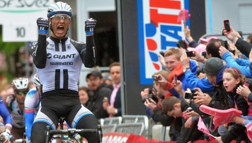 Marcel Kittel of the Giant-Shimano team celebrates after winning the second stage.  Photograph: Luca Zennaro/EPA