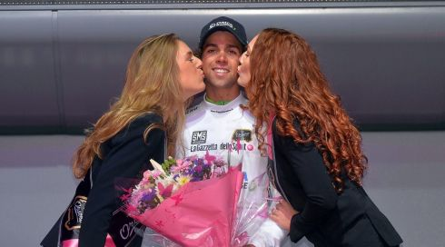 Australian rider Michael Matthews of the Orica GreenEdge team is feted on the podium wearing the best young rider's white jersey after the second stage of the 97th Giro d'Italia  in Belfast. Photograph: Luca Zennaro/EPA