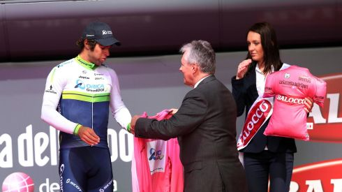 Northern Ireland First Minister Peter Robinson with Orica GreenEdge's Michael Matthews as he claims the Pink Jersey as overall leader after Stage 2.  Photograph: William Cherry/Presseye/Inpho