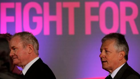 Northern Ireland First Minister Peter Robinson and Deputy First Minister Martin McGuinness leave the stage after the presentations for Stage two of the 2014 Giro D'Italia in Belfast. Photograph: Brian Lawless/PA Wire
