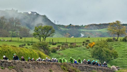 The peloton on a hilly part of the Antrim coast road. Photograph: Morgan Treacy/Inpho