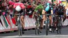 Giant-Shimano's Marcel Kittel (left red jersey) comes home to win stage threeof the Giro d'Italia in a sprint finish on Merrion Square in Dublin. Photograph: Donall Farmer/Inpho.