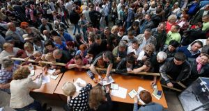 People queue to receive ballot papers during the referendum on the status of the Donetsk region in the eastern Ukrainian city of Mariupol yesterday. Photograph: Marko Djurica/Reuters