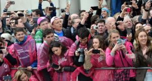 Spectators line the street for the best view of the finish of stage three of the Giro d'Italia on Merrion Street, Dublin, yesterday. Photograph: Eric Luke