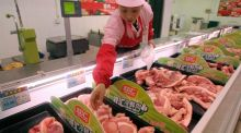 "Pork at a  supermarket in Nantong, Jiangsu province:  China's WH Group Ltd, the world's biggest pork company, has cancelled its IPO because of ""deteriorating market conditions and excessive market volatility"". Photograph: Reuters"