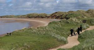 Golfers walk along the coastal path on the Doonbeg Golf Links course in Co Clare. Donald Trump has said he will invest up to €45 million on the course.