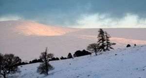 Sun setting on Mullaghcleevaun in winter, from Kippure Estate.  Photograph: Michael Delahunty
