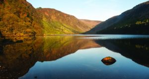 Glendalough's Upper Lake at sunrise.  Photograph: Michael Delahunty