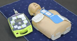 An automated external defibrillator (AED) and dummy. A volunteer can be trained in their use to save lives. Photograph: Thinkstock
