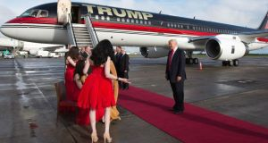 American tycoon Donald Trump listens to music from Affinity after disembarking from his personally-customised 757 plane at Shannon Airport yesterday.