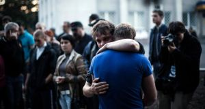 Two men react after Ukrainian national guardsmen opened fire on a crowd outside a town hall in Krasnoarmeisk, about 30 km from the regional capital Donetsk during polling on Sunday.  Photograph: AP Photo/Manu Brabo