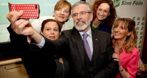 Taking a selfie: Sinn Féin deputy leader Mary Lou McDonald with president Gerry Adams and candidates Liadh Ní Riada, Lynn Boylan and Martina Anderson at yesterday's launch of Sinn Féin's manifesto in  Dublin. Photograph: David Sleator/The Irish Times