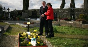 Andrew Dolan's parents, Joe and Rosie, at his graveside in Ardcarne Cemetery , Co Roscommon.  Photograph: Brian Farrell