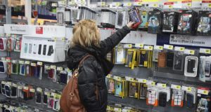A customer looks at Apple iPhone accessories at a Best Buy store in Northbrook, Illinois. Photograph: Tim Boyle/Bloomberg