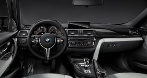 M3's cabin is standard 3 Series fare but with terrific high-back buckets