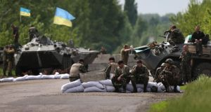 Ukranian military soldiers man a highway checkpoint  near Slovyansk, Ukraine. Photograph: John Moore/Getty