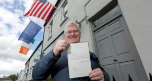 Philip Sheppard of Sheppard's Irish Auction House  in Durrow, Co Laois, with a letter dated October 1, 1964, from Jaqueline Kennedy to Fr Fagan at All Hallows College in Dublin in relation to Father Leonard's death. Photograph: Dylan Vaughan