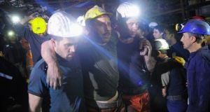An injured miner is carried to an ambulance after being rescued this morning from a coal mine he was in trapped in, in Soma, a district in Turkey's western province of Manisa. Photograph: Emre Tazegul/Reuters
