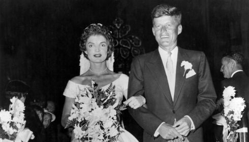 John Fitzgerald Kennedy (1917 - 1963), then Democratic senator for Massachusetts, escorts his bride Jacqueline Lee Bouvier down the church aisle shortly after their wedding ceremony at Newport, Rhode Island, in September 1953. Photograph: Keystone/Getty Images