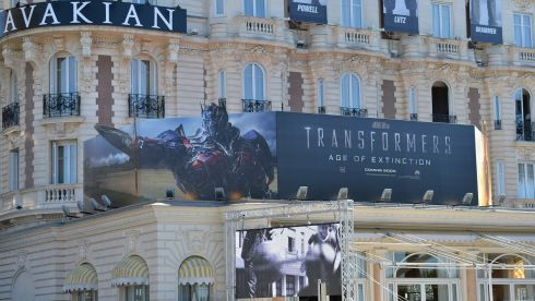 A poster for Transformers - Age of Extincion up in lights in Cannes. Photograph: Michael Buckner/Getty Images