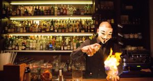 Preparing a drink at Anonymous Bar