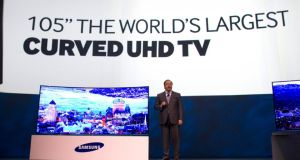 Joe Stinziano, executive vice-president of Samsung Electronics America, introduces a 105-inch, curved ultra-high-definition (UHD) television during the Consumer Electronics Show in Las Vegas in January. photograph: steve marcus/reuters