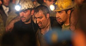 Miners are helped by rescue workers and friends from the coal mine  in Soma. The disaster in western Turkey is likely to be the country's deadliest and is also the worst in a series of incidents in a sector that has seen 30,000 die since 1970. Photograph: Ozgu Ozdemir/Getty Images