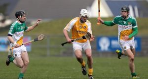 Antrim's Neil McManus with Offaly's Kevin Connolly and Conor Mahon