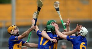 Henry Shefflin finds his path blocked by Tipperary's Kieran Bergin, Cathal Barrett and Brendan Maher during the Allianz Hurling League final. The Kilkenny forward suffered a stress fracture in his foot during the match and will be sidelined for at least six more weeks.