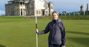 Madeleine Lyons on the 18th green of the Old Course at St Andrews. The Royal and Ancient headquarters is in the background