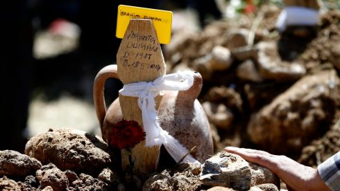 A makeshift grave marker for late miner Ibrahim Duman, a victim of the coal mine blast. Photograph: Tolga Bozoglu/EPA