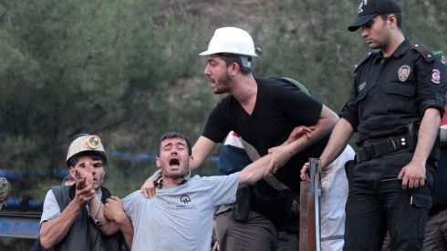 A relative of a trapped miner at the mine site in Soma. Photograph: Ahmet Sik/Getty Images