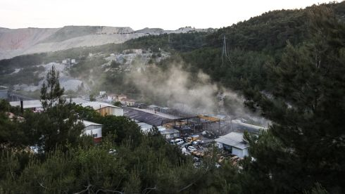Smoke billows from the coal mine's opening.  Photograph: Ozgu Ozdemir/Getty Images