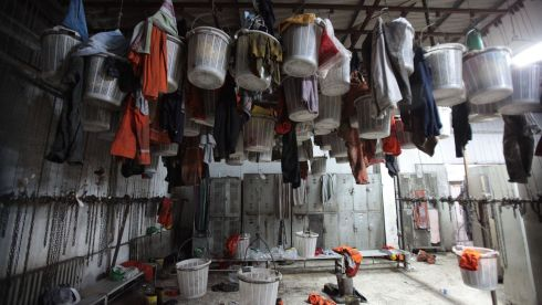 Full clothes baskets belonging to trapped miners hang in the empty changing rooms at the mine. Photograph: Ahmet Sik/Getty Images