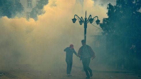 Tear gas is used against protesters. Photograph: Reuters