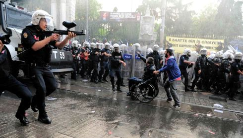 Riot police fire plastic paintball gun pellets to disperse protesters in Istanbul. Photograph: Yagiz Karahan/Reuters