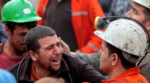 Miners react to the tragedy on the surface. Photograph: Ahmet Sik/Getty Images