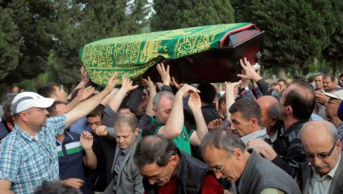 People carry the coffin of a miner in preparation for burial.  Photograph: Reuters