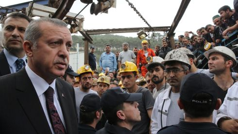 Turkish prime minister Recep Tayyip Erdogan speaks to rescue team members at the mine site. Photograph: Turkish government handout/EPA