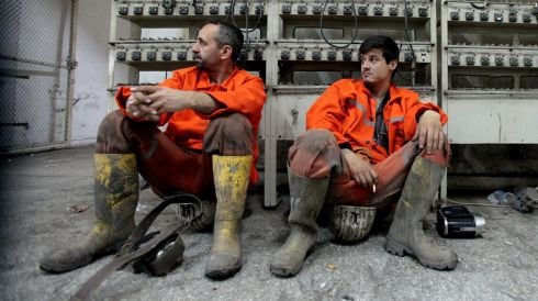 Miners rest as they await their trapped colleagues. Photograph: Ahmet Sik/Getty Images