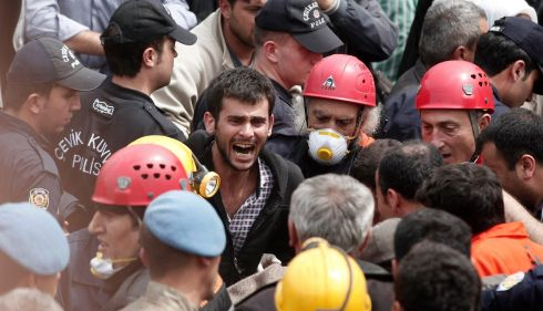 A relative of a miner expresses anger at the unfolding events. Photograph: Osman Orsal/Reuters