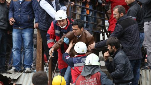 A family member attempts to get closer to the mine entrance at Soma. Photograph: Ozgu Ozdemir/Getty Images