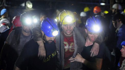An injured miner is helped by colleagues. Photograph: Emre Tazegul/Reuters