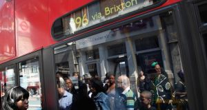 A woman boards a bus in Brixton. Photograph: Dan Kitwood/Getty Images