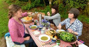Geraldine Kavanagh of Wicklow Wild Foods with Emma and Ellie Somers with their foraged food picnic at Avondale estate, Co Wicklow. Photograph: David Sleator