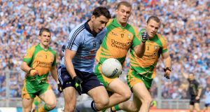 Dublin's Bernard Brogan followed by Paddy McGrath, Eamonn McGee and Neil McGee of Donegal in the 2011 All-Ireland semi-final. Photograph: James Crombie/Inpho