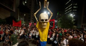 Hundreds of demonstrators in São Paulo protest against money spent on World Cup preparations. Photograph: Andre Penner/AP