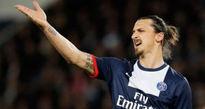 PSG striker Zlatan Ibrahimovic was a big money signing for the French club. Photograph:  Dean Mouhtaropoulos/Getty Images